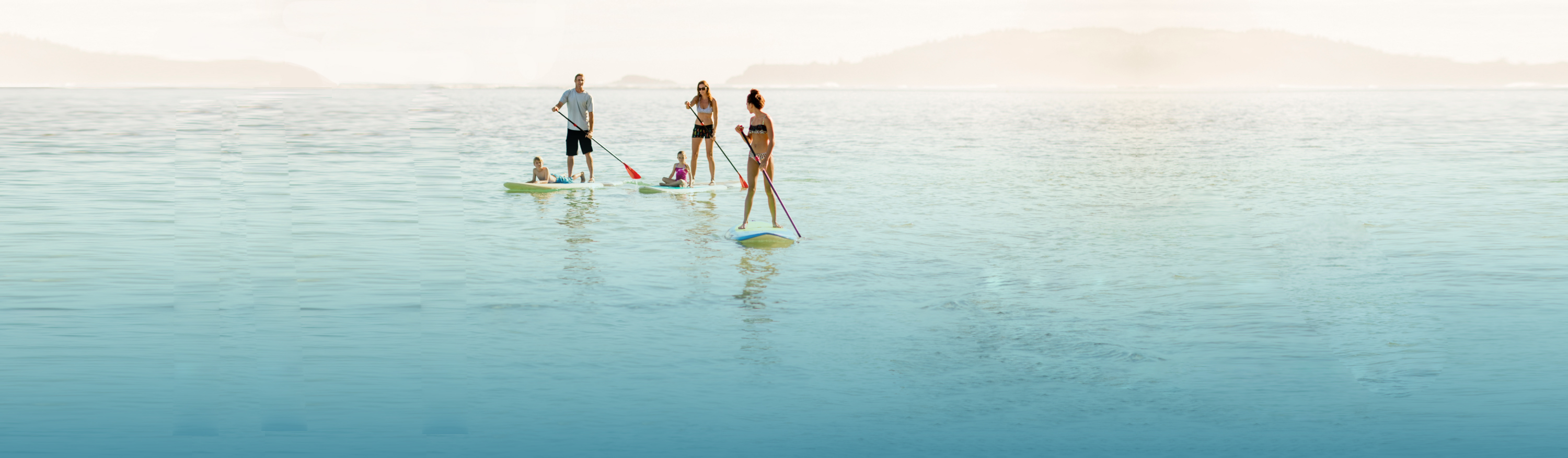 Family paddleboarding in the ocean
