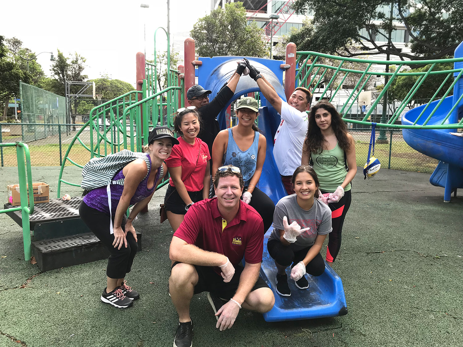 Group of people helping out at a playground outdoors
