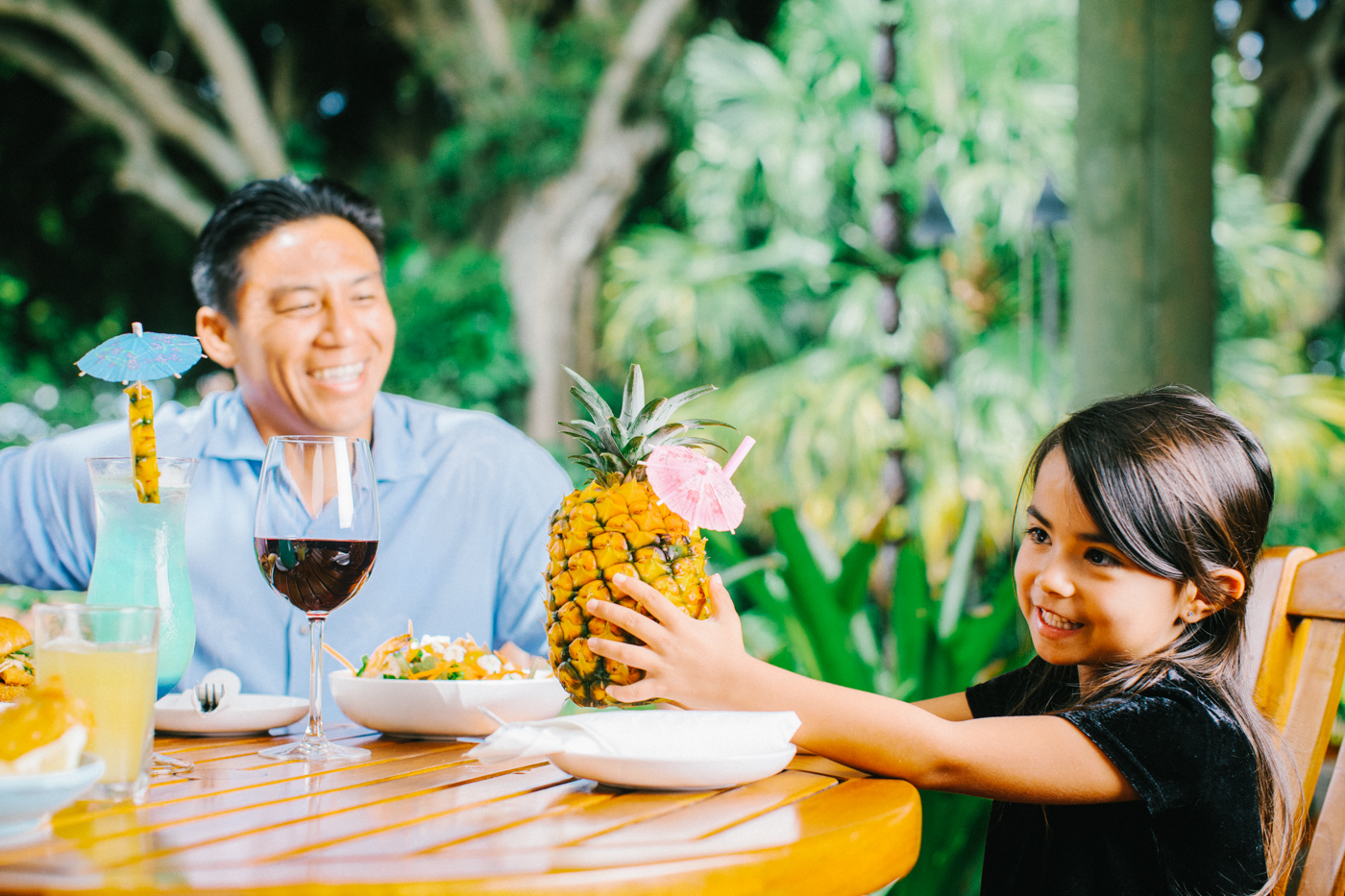 Father and Daughter with large pineapple drink