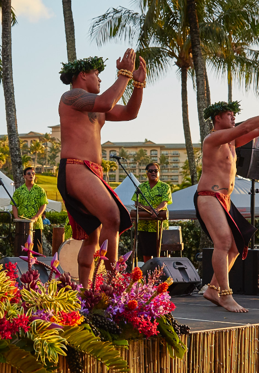 Hawaiian dancers performing traditional song and dance